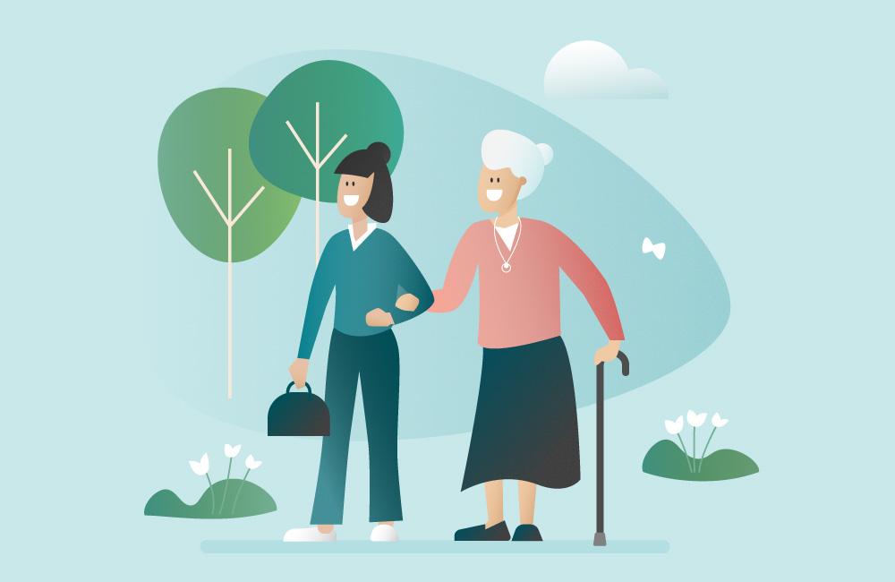 aide à domicile tenant par le bras une femme âgée lors d'une balade